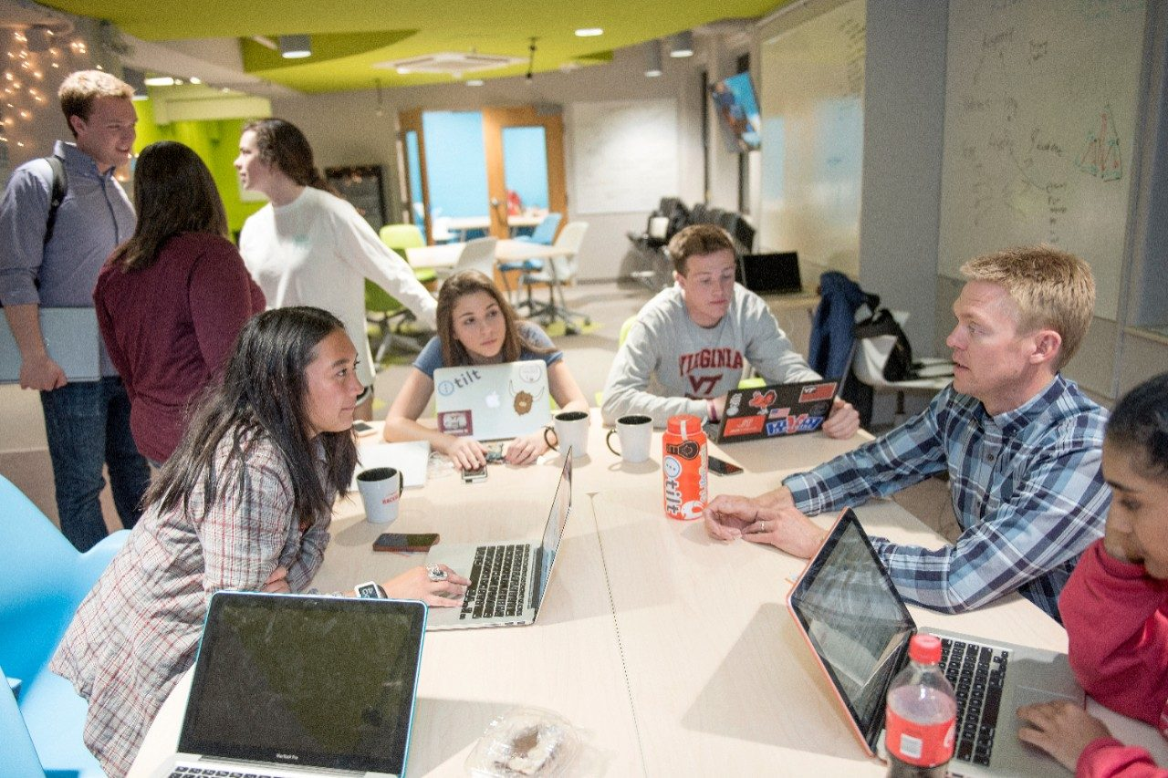 Program Director Sean Collins works with Innovate students in the Venture Lab