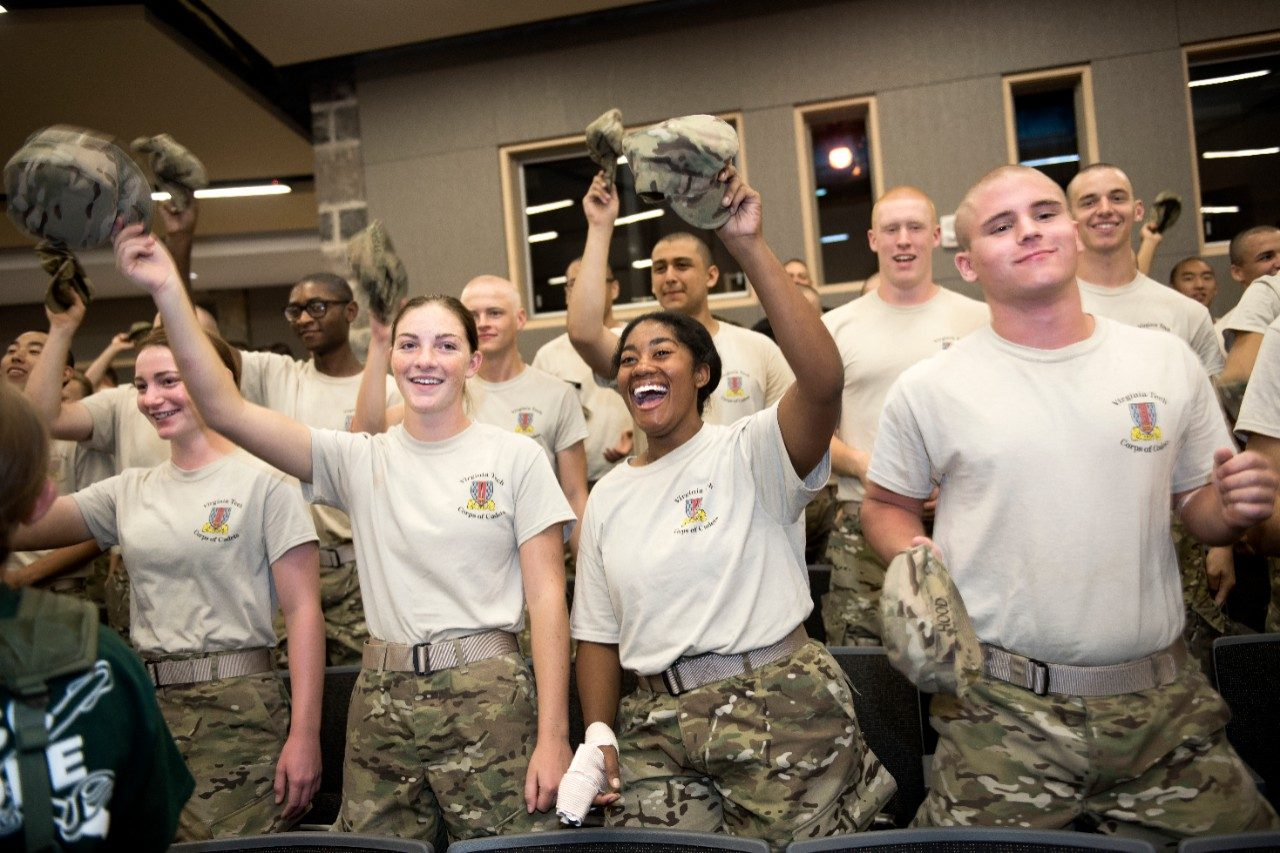 Members of the Corps participate in a pep rally