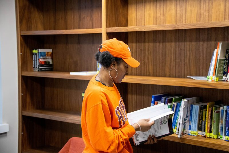 Senija Davis reads in the library in O'Shaughnessy Hall